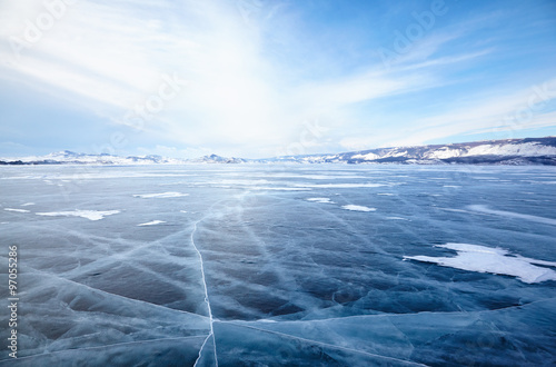 Poster Lac / Etang Winter ice landscape on lake Baikal with dramatic weather clouds