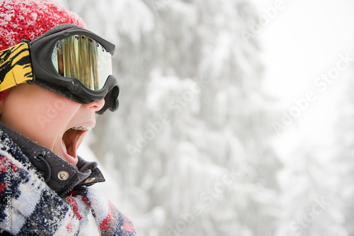 Boy wearing ski goggles Wallpaper Mural