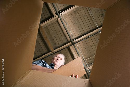 Photo Man looking in cardboard box
