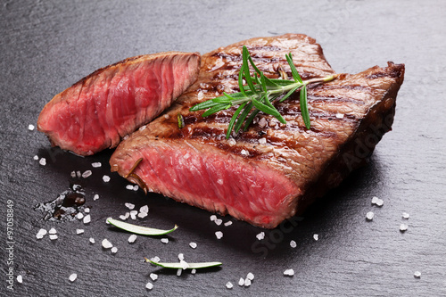 Poster de jardin Steakhouse Grilled beef steak with rosemary, salt and pepper
