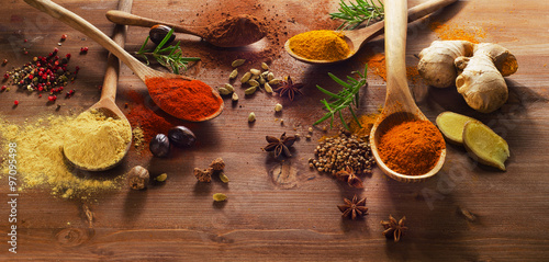 plakat Spices and herbs on wooden table.