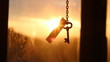 """Key and text """"success"""" against sunset rays Light. Golden key to success concept."""