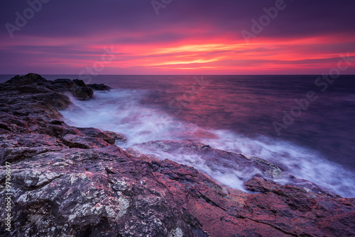 Poster Eggplant Rocky sunrise. Magnificent sunrise view in the blue hour at the Black sea coast, Bulgaria.