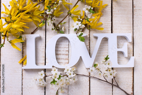 Word love and flowering branches with yellow and white flowers #97130608
