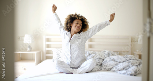 Young Woman Awaking On The Bed