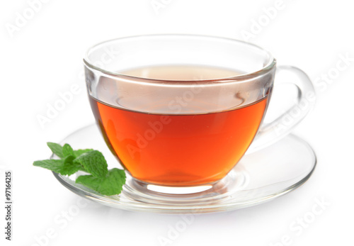 Staande foto Thee Glass cup of tea with mint leaves isolated on white background