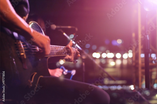Photo Guitarist on stage for background, soft and blur concept