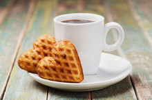 Waffle Biscuits In Shape Of Heart With Cup Of Coffee On Vintage Background For Valentines Day