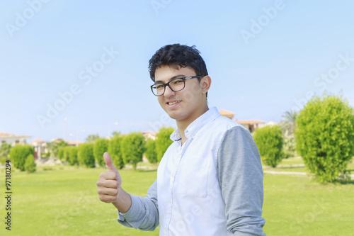 Fotografía  Teenager with eyewear showing the thumb up,agreement.