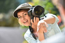 Young Woman Photographer Doing A Photoshoot With Model