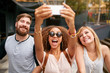 canvas print picture - Group of smiling friends taking selfie with smart phone