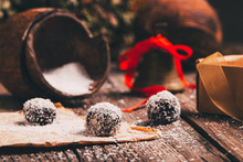 Coconut Chocolate Balls With Christmas Decoration In A Background