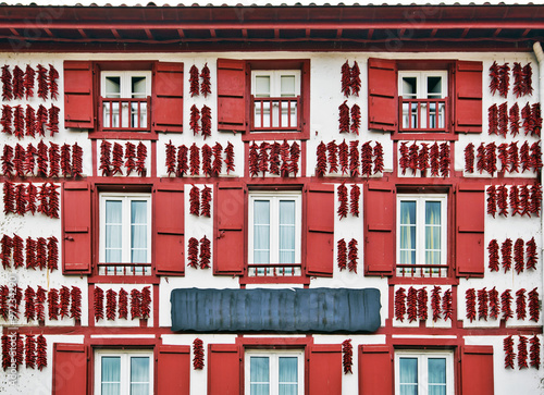 Red Espelette peppers drying in the wall of Basque house