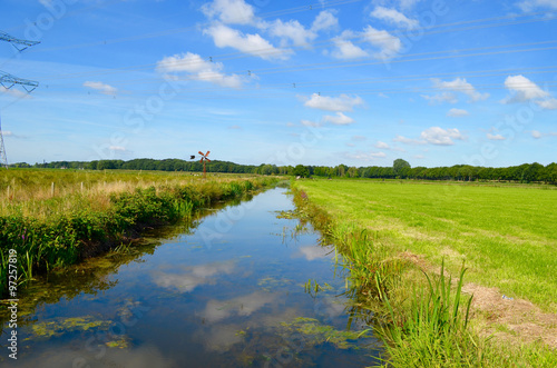 Fotografija Ditch and green polder landscape in summer in the Netherlands