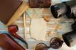 Travel background - binoculars, notebook, wallet, money, box, sunglasses and smoking pipe