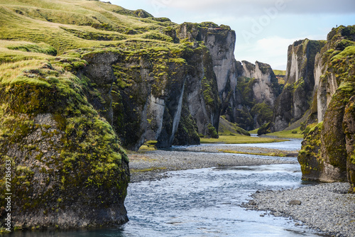Photo Stands Canyon Fjadrargljufur canyon with river, Iceland