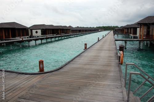 Fotografie, Obraz  Timber pier and bungalow at Maldives