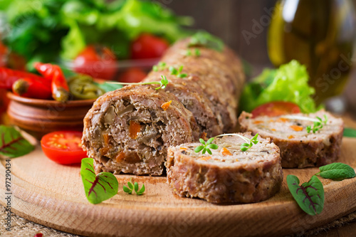 Photo  Minced meat loaf roll with mushrooms and carrots