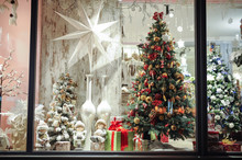 Gift Boxes , Sweets And Christmas Decor In Shop Window