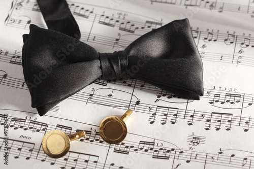 Fotografie, Obraz  Formal Black Bow Tie and Cuff Links on Sheet Music