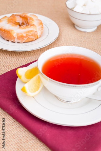 Tea Breakfast with pastries, and hot tea with lemon.