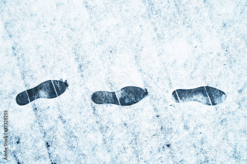 Shoe prints in the fresh snow on the wooden bridge  Danger walking