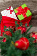Christmas tree with gift box and decorations on wooden backgroun