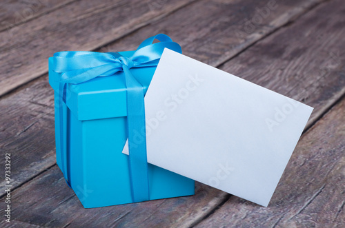 Fotografie, Obraz  Blue Gift Box With Envelope on a Rustic Wooden Surface