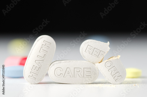 Fotografie, Obraz  Stack of pills with HEALTH CARE REFORM stamped in pills with the REFORM pill bro