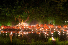 Buddhist Monk Fire Candles To The Buddha With Beautiful Water Re