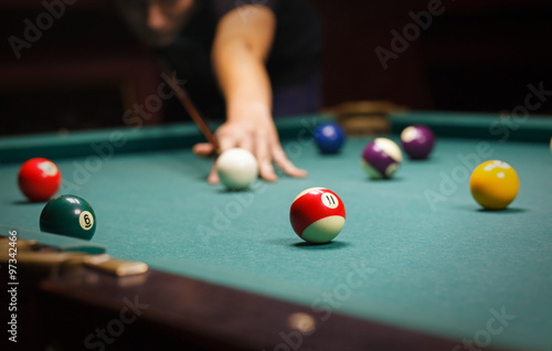 Fotografie, Tablou  man playing billiard