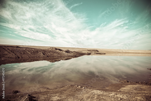 Poster Cappuccino Iraqi landscape in winter with reflection of clouds on the surface of water