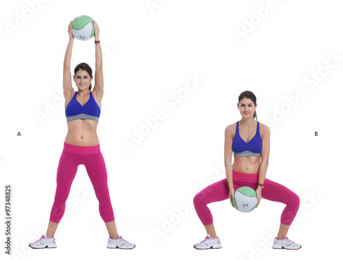 Medicine Ball Squat with Overhead Lift - Buy this stock photo and