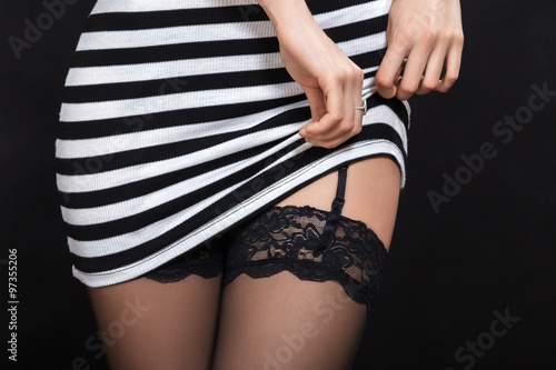woman shows her stockings Canvas-taulu