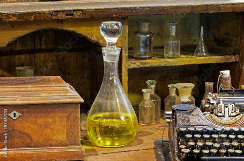 The Old Decanter And Typewriter On Dusty Table