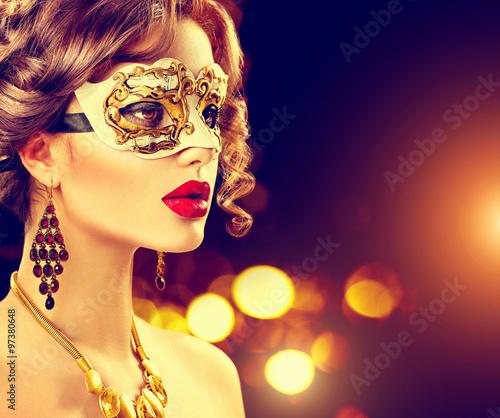 Foto op Aluminium Carnaval Beauty model woman wearing venetian masquerade carnival mask at party