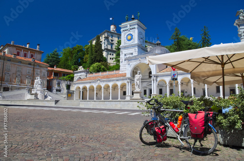 Bike parked in Piazza Libertà, Udine, Italy: riding along the Alpe Adria cycle r Canvas Print