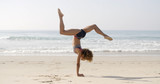 Woman Practicing Yoga Outdoors - 97391648