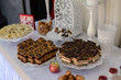 Delicious sweet buffet with cupcakes, tiramisu glasses and other