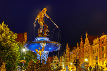 Obraz na Szkle Gdańsk Fountain of Neptune in Gdansk at night, Poland