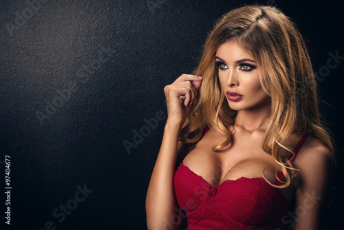 Fotografie, Obraz  Blonde sexy woman posing in red lingerie