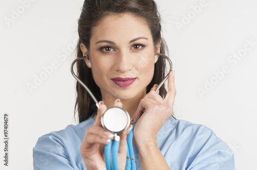 Fotografie, Obraz  Female doctor holding up the disc of a stethoscope