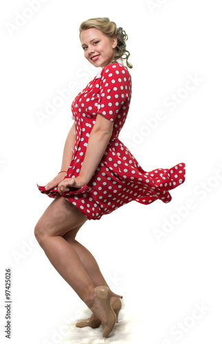 Valokuva  Girl in a red polka dot dress