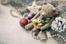Christmas Card With Teddy Bear, Necklace, Pine Cone, Christmas Tree Toys For Your Design. Grunge Christmas Background.