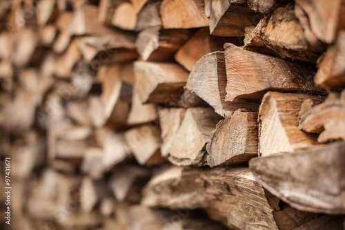 Poster Bois background of Heap firewood stack, natural wood