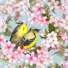 Fototapeta Ptaki Seamless repeated floral pattern - pink cherry, sakura and apple flowers with birds. Watercolor