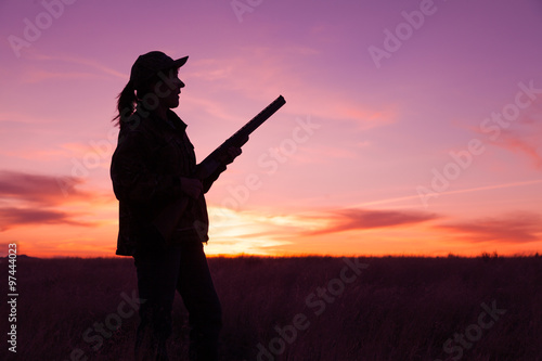 Foto op Canvas Jacht Hunter Silhouetted at Sunset