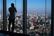 Man taking photo of Tokyo Tower with smartphone from Tokyo City View in Roppongi