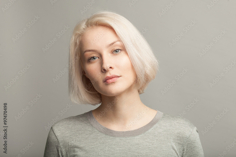 Fototapeta close up portrait of young beautiful blonde woman on gray background