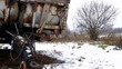 Rusted trailer on winter field